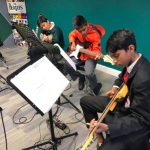 Guitar Lessons that are fun and graded, in a safe group environment at Music Gym